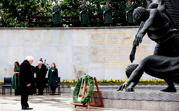 Heroes remembered: President Michael D Higgins bows his head as he lays a wreath at the Garden of Remembrance yesterday for all those who died in the Easter Rising Photo: David Conachy