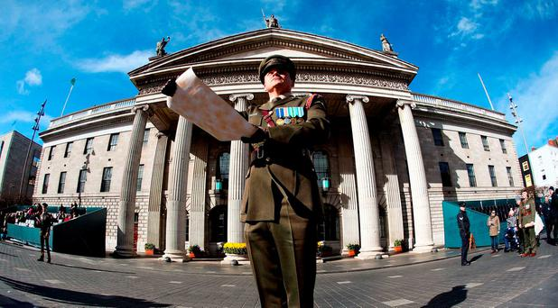 Handout photo issued by the Government of Captain Peter Kelleher from the 27th Infantry Battalion, reading the Proclamation at the GPO. Photo: Maxwells/PA Wire