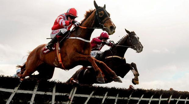 Eventual winner Acapella Bourgeois, left, with Jonathan Burke up, clears the final hurdle alongside Nambour, with Bryan Cooper up, on their way to winning the Agnelli Motor Park Novice Hurdle. Horse Racing at the Fairyhouse Easter Festival. Fairyhouse, Co. Meath. Picture credit: Cody Glenn / SPORTSFILE