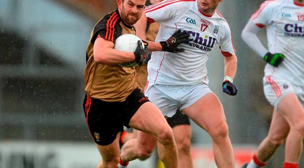 Down's Mark Poland tries to fend off Cork's Colm Hyde. Picture credit: Piaras Ó Mídheach / Sportsfile