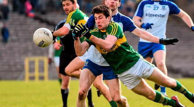 Kerry's Paul Geaney battles for possession with Monaghan's Karl O'Connell. Photo: Stephen McCarthy / Sportsfile