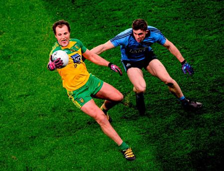 Donegal's Michael Murphy gives David Byrne the slip. Photo: Dáire Brennan / Sportsfile