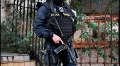 An armed garda on the streets after the recent gang violence