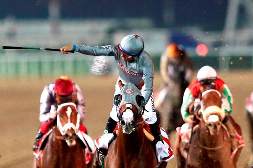 Victor Espinoza rides California Chrome to victory in the Dubai World Cup Photo: Getty