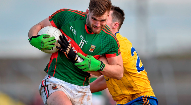 Mayo's Aidan O'Shea brushes through the tackle of Roscommon's John McManus during yesterday's league game Picture credit: Brendan Moran / Sportsfile