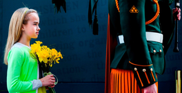 A young girl holding daffodils at the GPO. Photo: Maxwells