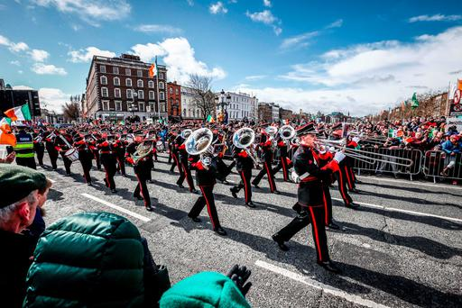 Huge crowds watch as marching bands proceed down O'Connell Street. Photo: Conor McCabe
