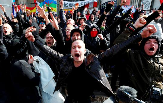 Right-wing demonstrators protesting against terrorism in front of the old stock exchange in Brussels Photo: Reuters