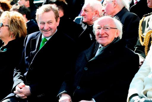 Acting Taoiseach Enda Kenny chats to President Michael D. Higgins at the Easter Sunday Commemoration Ceremony and Parade. Photo: Maxwells