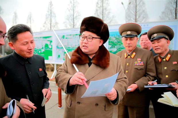 North Korean leader Kim Jong Un (C) speaks at an event declaring the construction of Ryomyong Street, in this photo released by North Korea's Korean Central News Agency (KCNA)