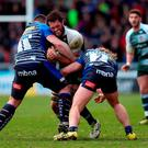 Eifion Lewis Roberts (L) and Tommy Taylor of Sale Sharks tackle Lawrence Pearce of Leicester Tigers during the Aviva Premiership match between Sale Sharks and Leicester Tigers at the AJ Bell Stadium yesterday
