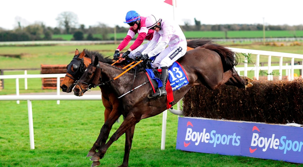 Fairyhouse 28-3-16 ROGUE ANGEL & ger Fox (Inside) jump the last to win the Boylesports irish Grand National from BLESS THE WINGS & Ruby Walsh (Near side)(WWW.HEALYRACING.IE)