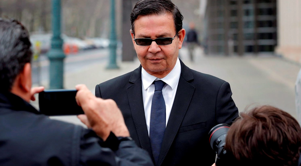 Rafael Callejas, the former president of Honduras, departs after pleading guilty in a hearing at U.S. Courthouse for the Eastern District of New York in the Brooklyn borough of New York March 28, 2016. REUTERS/Lucas Jackson