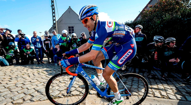 A picture taken on March 25, 2016 shows Belgium's Antoine Demoitie of Wanty-Groupe Gobert competes during the 59th edition of the E3 Prijs Vlaanderen Harelbeke cycling race, 215,3km from and to Harelbeke on March 25, 2016. Belgian cyclist Antoine Demoitie has died on March 27, 2016 after he was struck by a motorbike following a fall during the Gent-Wevelgem race in Belgium, police said. / AFP PHOTO / Belga / DIRK WAEM / Belgium OUTDIRK WAEM/AFP/Getty Images