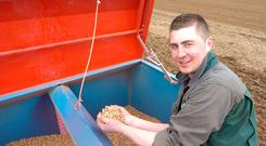 Gavin Weldon checking the beans for sowing in Finnegan Brothers farm at Balrath, Co Meath. Photo: Seamus Farrelly.