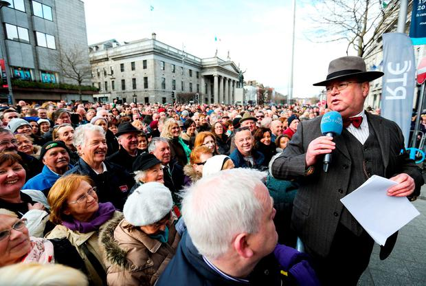 RTE Radio Presenter Joe Duffy performs an outside broadcast on O'Connell Street, as part of the RTÉ Reflecting the Rising (in partnership with Ireland 2016) celebrations on Easter Monday