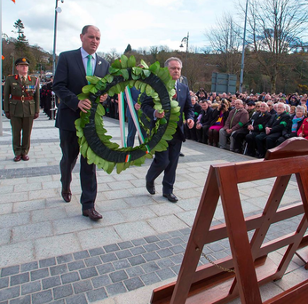 Paul Kehoe and Brendan Howlin lay a wreath in Enniscorthy Photo: Patrick Browne