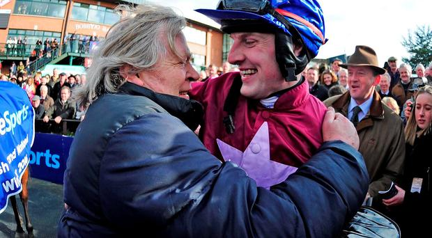 Jockey Ger Fox celebrates with trainer Mouse Morris after winning the Boylesports Irish Grand National Chase on Rogue Angel in 2016
