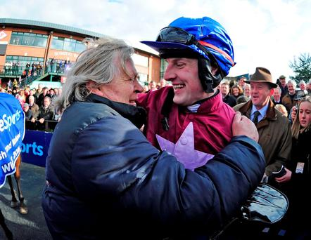 Jockey Ger Fox celebrates with trainer Mouse Morris after winning the Boylesports Irish Grand National Chase on Rogue Angel