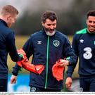 Ireland assistant manager Roy Keane with James McClean, left, and Cyrus Christie during squad training