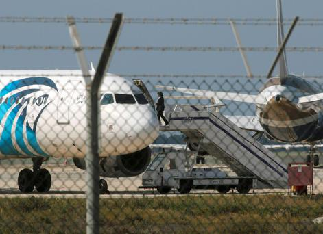 An official boards a hijacked Egyptair A320 Airbus at Larnaca Airport in Larnaca, Cyprus, March 29, 2016.REUTERS/Yiannis Kourtoglou