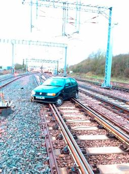 Car found abandoned on a railway line near Pitsea, Essex, shortly after 4.15am on Tuesday Credit: Network Rail/PA Wire