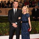 Naomi Watts (L) and Liev Schreiber arrive on the red carpet for the 88th Oscars on February 28, 2016 in Hollywood, California. AFP PHOTO / VALERIE MACON / AFP / VALERIE MACON