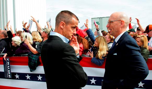 U.S. Republican presidential candidate Donald Trump's campaign manager Corey Lewandowski (L) speaks with an unidentified aide REUTERS/William Philpott/Files