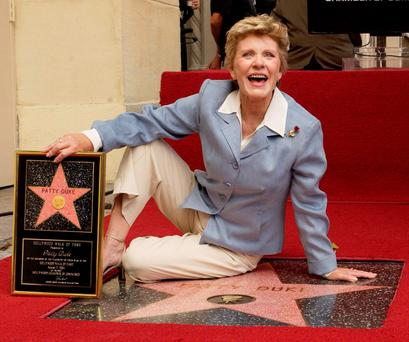 Award-winning actress Patty Duke poses for photographers following an unveiling ceremony honoring her star on the Hollywood Walk of Fame REUTERS/Jim Ruymen/Files