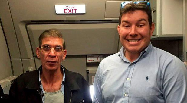 British passenger Ben Innes poses for a photograph alongside the hijacker Photo: Twitter