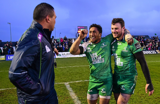 Connacht head coach Pat Lam congratulates Bundee Aki and Robbie Henshaw (right) following their victory over Leinster. Photo: Ramsey Cardy/Sportsfile