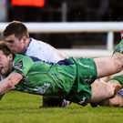 Connacht's Kieran Marmion scores his side's first try of the game, despite the attention of Leinster's Luke McGrath. Photo: Ramsey Cardy / Sportsfile