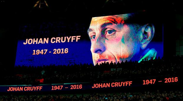 A tribute to Netherlands legend Johan Cruyff is shown on the giant screen throughout the 14th minute during the International Friendly match at Wembley