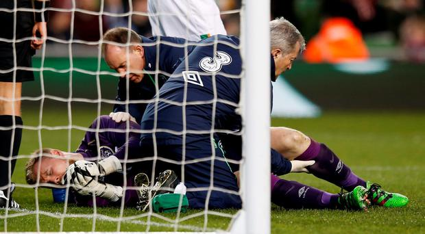 Republic of Ireland's Rob Elliot receives treatment after sustaining an injury before being substituted