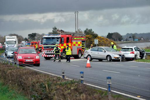 Emergency services at the scene of the crash. Photo: Darragh McSweeney