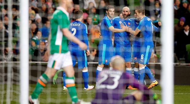 Slovakia's Robert Vittek celebrates with team mates after Republic of Ireland's Paul McShane scores an own goal and Slovakia's second