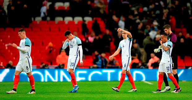 (left to right) England's Ross Barkley, Dele Alli, John Stones and Nathaniel Clyne walk off the pitch dejected after the International Friendly match at Wembley