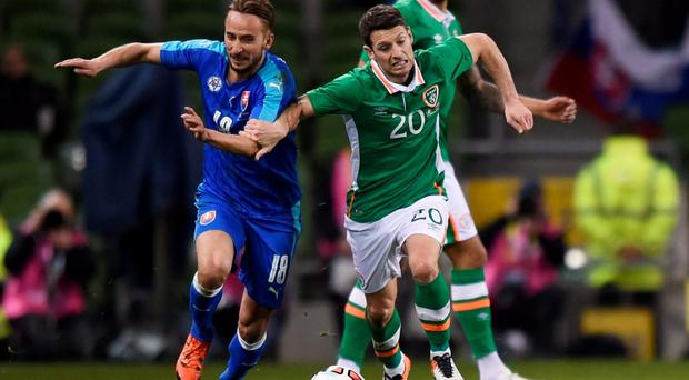 Republic of Ireland's Wes Hoolahan in action with Slovakia's Dusan Svento