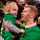 James McClean, who scored Ireland's second goal against Slovakia, celebrates with his biggest fan, daughter Allie-Mae (2), at the end of the game. Photo: David Maher, Sportsfile