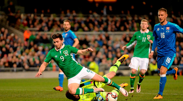 Republic of Ireland's Shane Long is fouled by Slovakia goalkeeper Matúš Kozácik resulting in the first penalty of the night (SPORTSFILE)