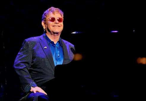 Elton John: strenuously denies allegations (AP)