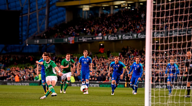 Shane Long shoots to score his side's first goal from the penalty spot