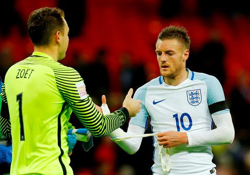 England's Jamie Vardy shakes hands with Netherlands' Jeroen Zoet after the game