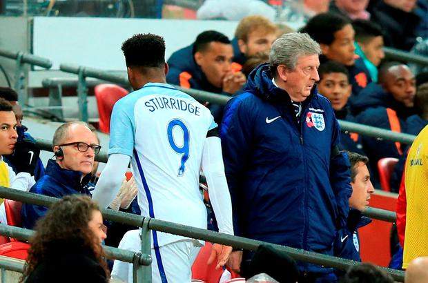 England's Daniel Sturridge (left) walks past manager Roy Hodgson after he is substituted