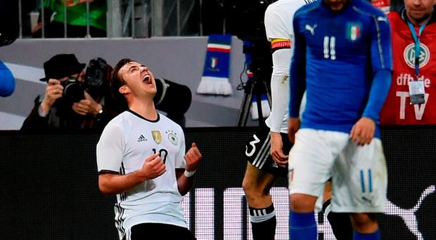 Mario Gotze of Germany (L) celebrates after scoring the second goal during the international friendly match between Germany and Italy