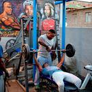 Men lift weight at a township gym in Johannesburg's Alexandra township. Reuters/Siphiwe Sibeko