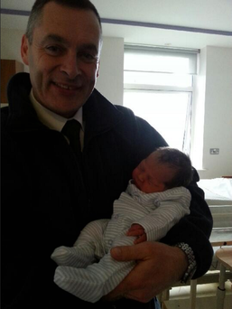 Hero Ryanair pilot Brian Coomey with baby Conor Brian, who he helped to deliver. Photo courtesy of the Evening Echo.