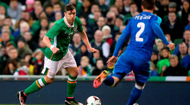 Republic of Ireland's Stephen Ward (left) runs at Slovakia's Peter Pekarik during last night's International Friendly at the Aviva Stadium