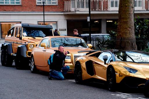 Three gold cars from Saudi Arabia (left-right) a 6x6 Mercedes G 63, Rolls-Royce Phantom Coupe and Lamborghini Aventador have received parking tickets on Cadogan Place in Knightsbridge, London. Photo: Stefan Rousseau/PA Wire