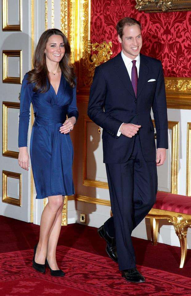 Kate Middleton, pictured with Prince William in the sapphire blue, 'Phyllis' wrap around dress.